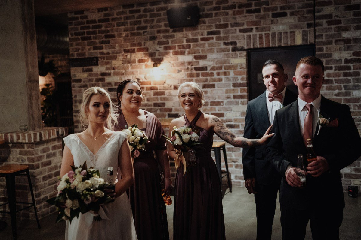 sandstone point hotel wedding photos jessica johnny